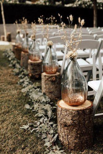 rust wedding color aisle with wooden stands and vases with pampas grass autumn nicole photo