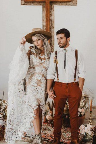 rust wedding color bohemian bridal couple with bride in lace dress and hat valeriethompsonphotography