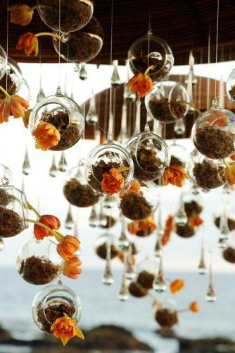 rust wedding color hanging décor glass balls with orange flowers chris + lynn photographers