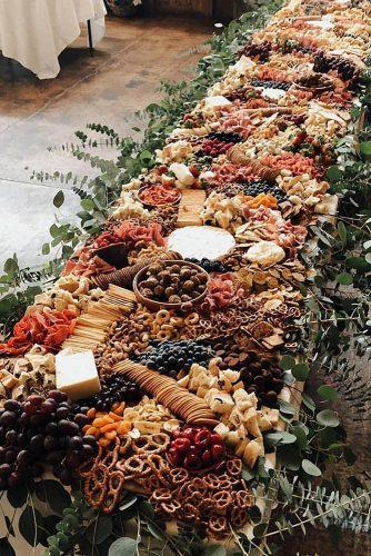 rust wedding color long catering table decorated with greenery savourandgraze