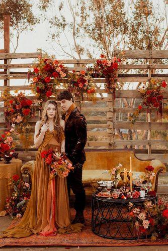 rust wedding color monochrome palette wooden crates décor with flowers and candles pacoandbetty