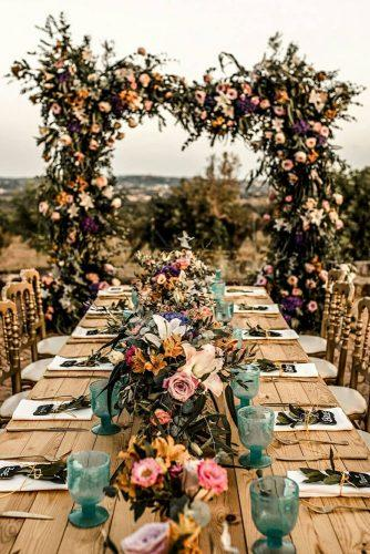 rust wedding color outdoor reception with bright flowers woodland table claudia_gerhard