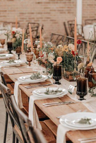 rust wedding color outdoor table reception with peach candles and flowers john david weddings