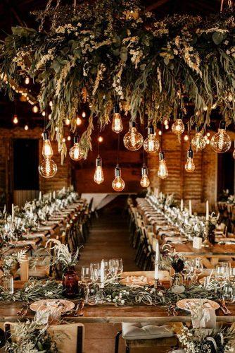 rust wedding color reception in barn with greenery and hanging lights chrisandruth