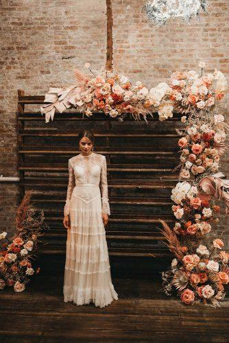 rust wedding color wooden pallette backdrop with roses and pampas grass kimberly chau photography