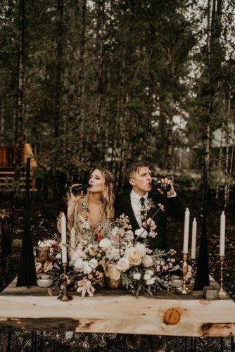 rust wedding color woodland wedding reception broom and bride table with flowers henry tieu photography