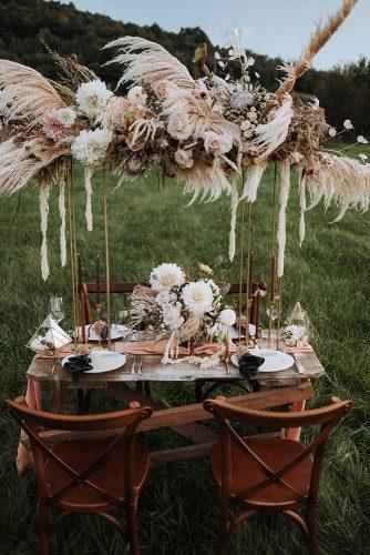 summer wedding trends outdoor bohemian wedding table in rust shades with pampas grass 602 Photography