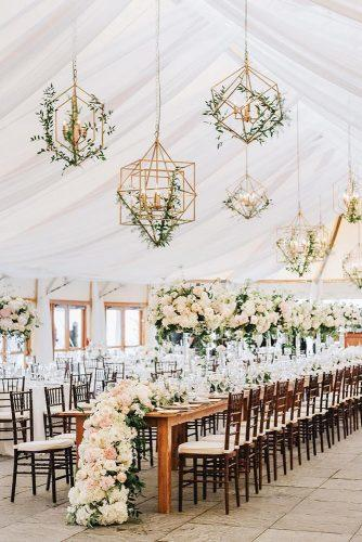 summer wedding trends reception under the tent with tall centerpieces white flower table runner and hanging geometry candles with greenry lenamirisola