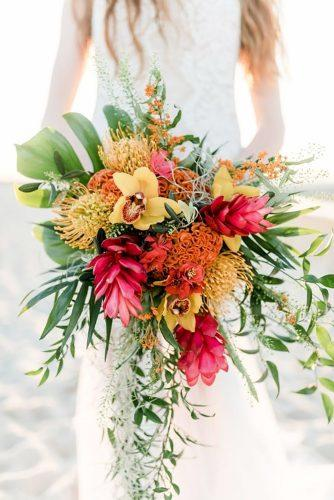 tropical wedding bouquets color cascade bouquet Sandra Huetzen Photograhpy
