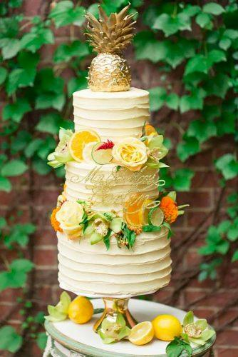tropical wedding cake trends tropical cake with pineapple cake topper The Dessert First Bakery