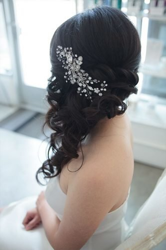 classic wedding hairstyles side swept dark hair down with silver pin kellyzhangstudio