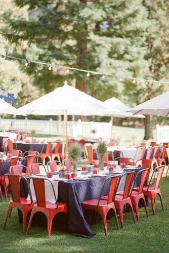 independence day wedding 4th of july blue tablecloth and red chairs outdoor reception ktmerry