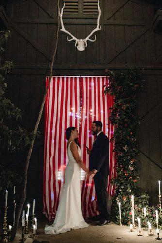 independence day wedding 4th of july ceremony with white red stripes backdrop devin jenkins