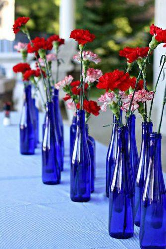 independence day wedding 4th of july red and white carnations flowers in blue bottles the lily pad cottage