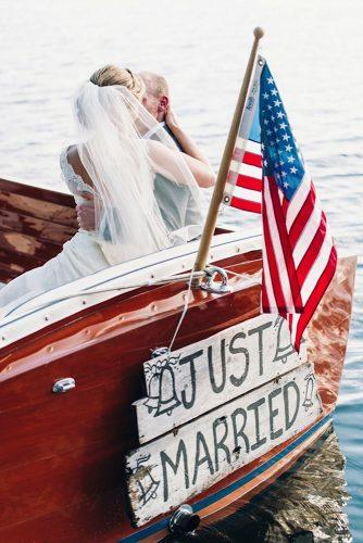 independence day wedding photography groom and bride in the boat decorated with american flag and sign justin & mary