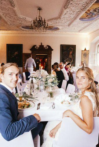real wedding schloss kronburg in memmingen bride groom on the table ytzweddings