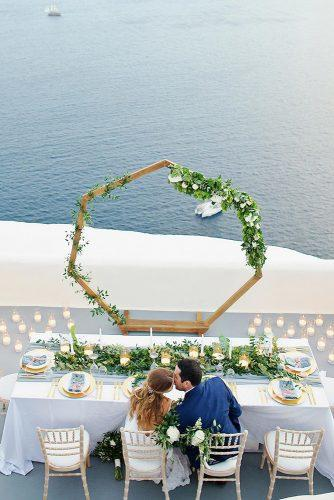 summer wedding trends outdoor reception long table with greenery thanasiskaiafas