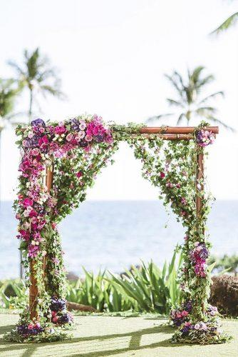 summer wedding trends outdoor wedding ceremony altar with greenery and bright flowers dmitriandsandra