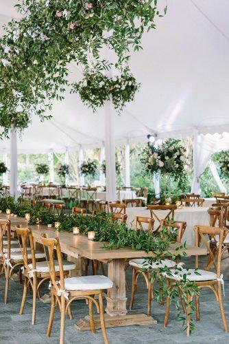 summer wedding trends reception under white tent with tall centerpieces and hanging greenery alisaferris