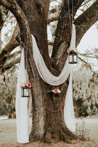 cheap wedding decorations white tulle on the tree Brandi Toole Photography