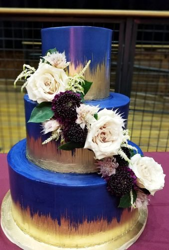 colored wedding cakes blue cake with floral cascade triplecrownbakery