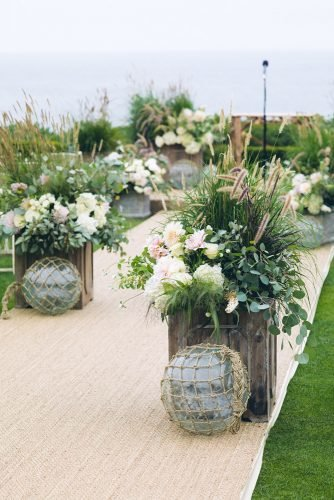 nautical wedding lurlap outdoos aisle with wooden boxes full of summer greenery coba images