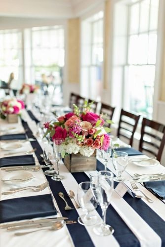 nautical wedding table decor with stripes on tablecloth and flower centerpiece shoreshotz photography
