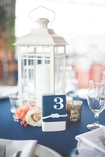 nautical wedding white and blue bridal centerpieces with white lantern and blue tablerunner shannon moffit photography