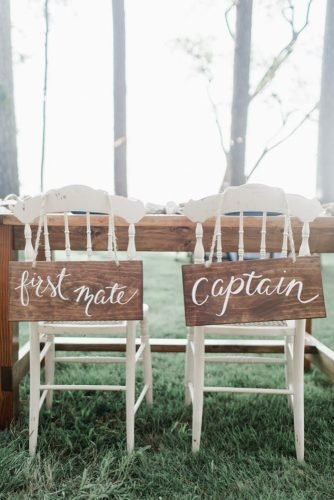 nautical wedding white chairs with wodden signs annamarie akins