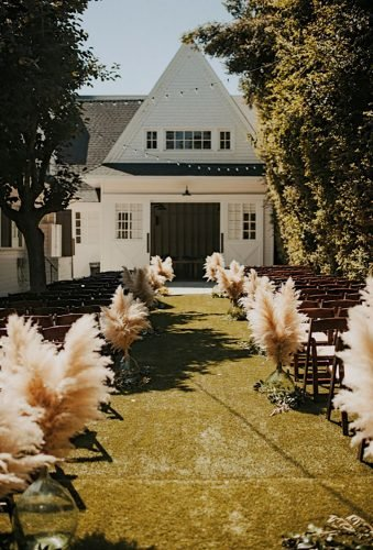 pampas grass wedding backyard ceremony decor Tyler Branch