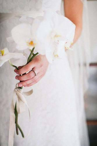 single stem wedding bouquets single orchid Tealily Photography