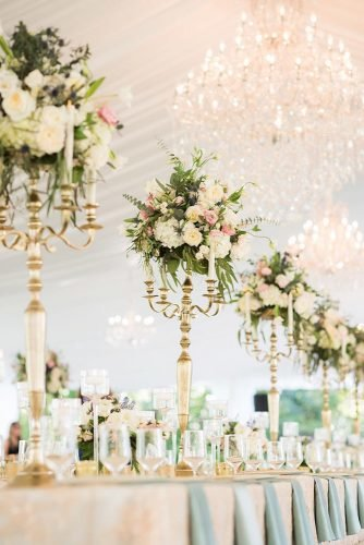 tall wedding centerpieces gold elegant with flowers and candles under white tent reception allisonlewisphotography