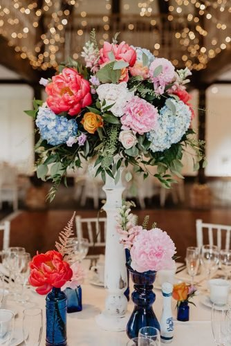 tall wedding centerpieces in wooden white vase colorful flowers kelsie low photography