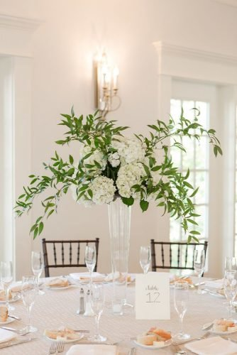 tall wedding centerpieces minimalist glass vase white flowers and greenery jamie blow photography