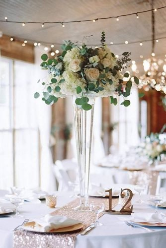 tall wedding centerpiecesbohemian glam reception tall glass vase white flowers and greenery crosscreekranchfl