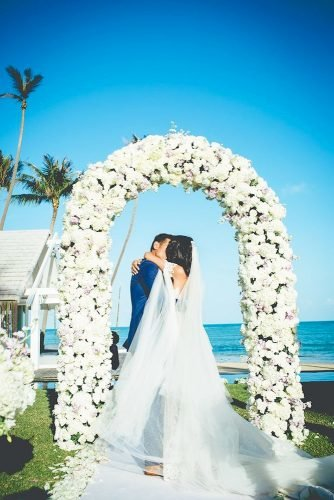wedding arch decoration ideas kiss under arch Akaphon Photography