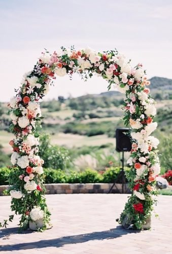 wedding arch decoration ideas red white arch Kurt Boomer Photography