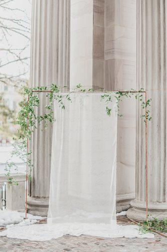 wedding ideas minimalist bridal altar with greenery and white cloth decorus fine art photography