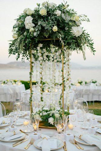 wedding ideas tall centerpiece with greenery and hanging white flowers white_lilac_rentals