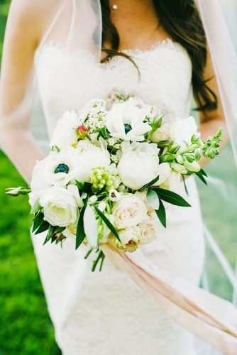 green wedding florals bouquet with tape onelove photography