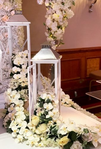 lantern wedding centerpiece ideas lantern with white flowers aelia events
