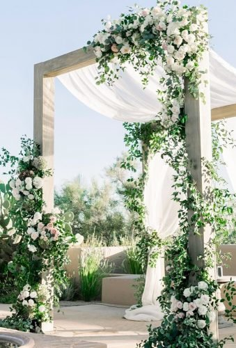 modern wedding decor greenery arch with tulle karliecolleenphotography⁣