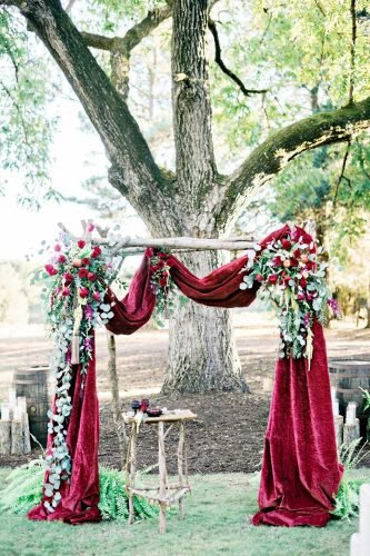 velvet wedding decor burgundy arch Andie Freeman Photography