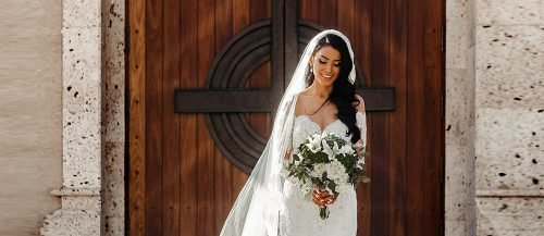 wedding hymns beautiful bride standing near church featured