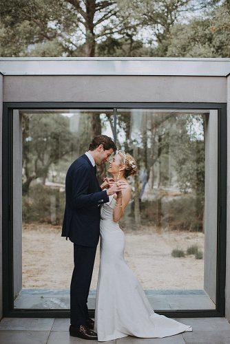 wedding photographers romantic couple near window