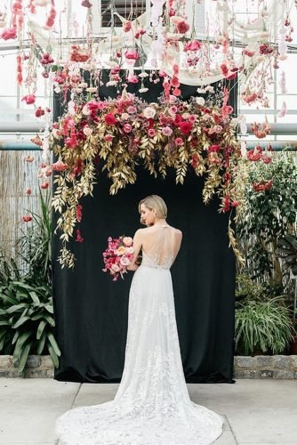 wedding trends 2020 black wedding backdrop and red hanging flowers emilywrephoto