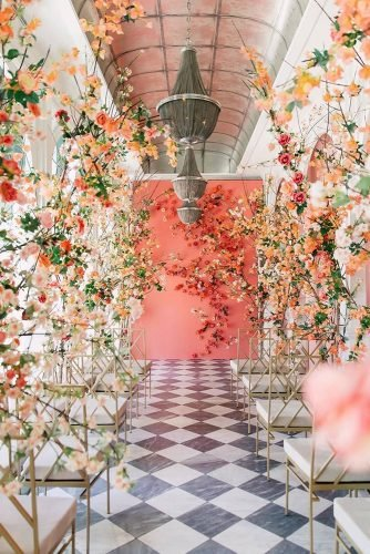 wedding trends 2020 coral mustard white flowers aisle and backdrop purpletreephotography