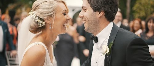 funny wedding ceremony script bride and groom laughing feaured
