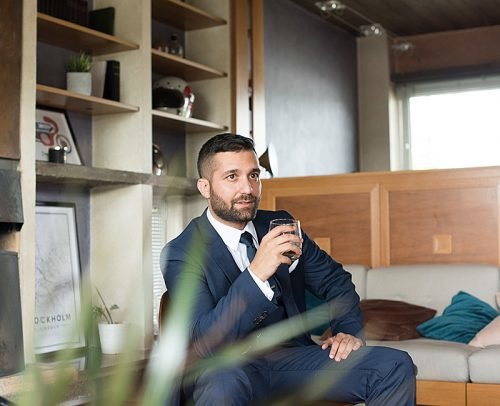how to be a gentleman man sitting with glass