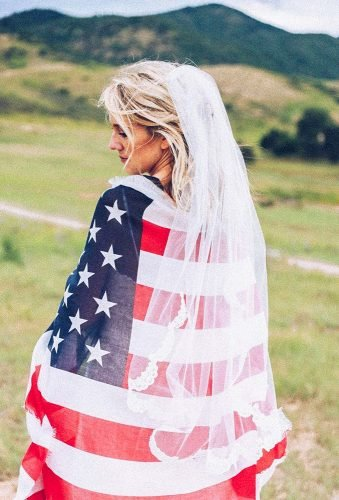 independence day wedding bride under flag callierieslingphotography